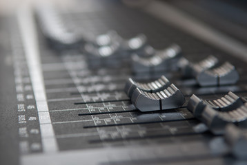 Close up professional studio mixing console fader in grey
