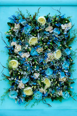 Colorful flower arrangement of blue roses and other flowers