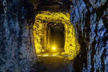 Abandoned and collapsed sandstone or  limestone mine illuminated by color lights