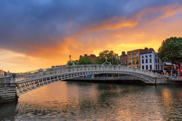 Ireland, Dublin, Halfpenny bridge and Liffey river at sunset