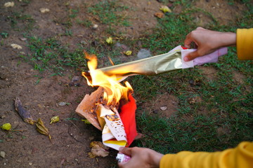 Set fire to paper on on the lawn