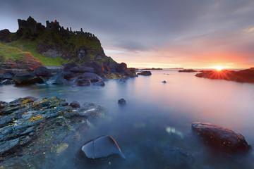 Europe, Northern Ireland, Antrim, Dunluce Castle at sunset