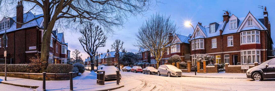 Winter sunrise in snowy suburb in London