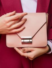 Fashionable girl  with  handbag close up. Stylish accessory.