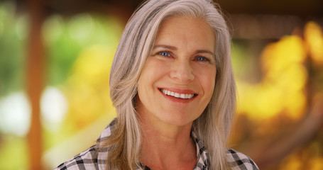 Lovely mature caucasian woman smiling outside