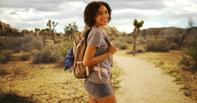 Cute African woman hiking Joshua Tree National Park