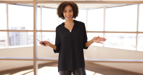 Casual black woman standing teaching speech