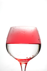 Wine glass with red smoke inside