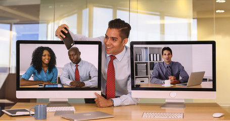 Businessman with same tie as colleague on video conference taking selfie with smartphone. Business worker with matching clothes laughing and being funny taking photograph together