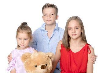 Brother and two sisters with a teddy bear