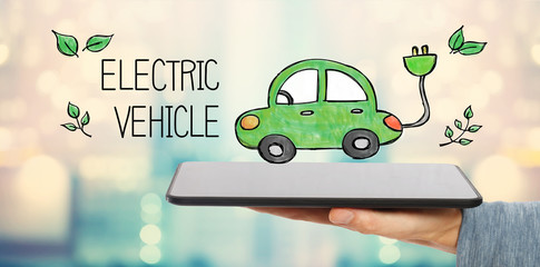 Electric Vehicle with man holding a tablet computer