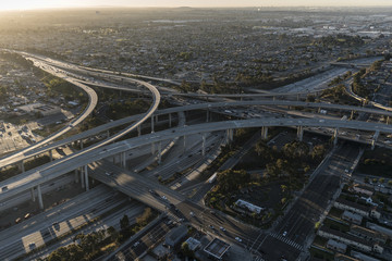 Aerial dawn view of 105 and 110 freeway interchange ramps in Los Angeles California.