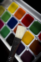 Colorful watercolors and a brush