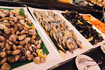 Enamel Venus Shell, Mussel, Prawn in seafood buffet line at hotel restaurant.