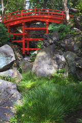 Red old bridge in University park in Tokyo Japan