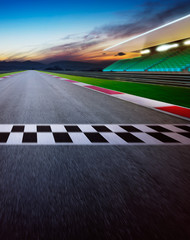 Foto auf Acrylglas F1 Motion blurred racetrack with start or end line . Night scene . Vertical or poster format .