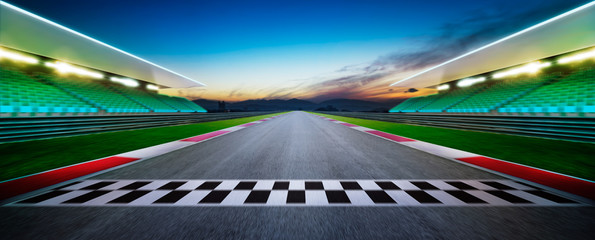 Fotobehang F1 Motion blurred racetrack with start or end line . Horizontal format .Night scene .