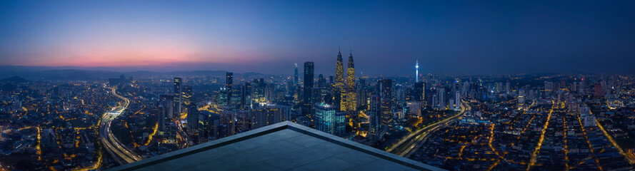 Open space balcony with Kuala Lumpur cityscape skyline view  . Night scene .