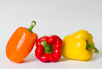 Three bell peppers together on white background