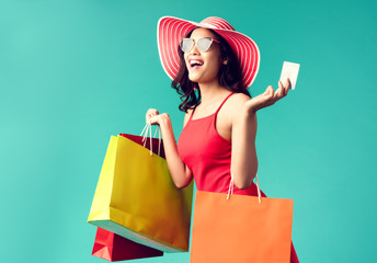 Women are shopping In the summer she is using a credit card and enjoys shopping.