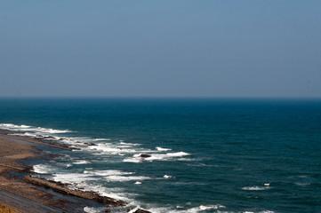 日南海岸と水平線と鬼の洗濯岩