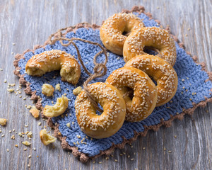 Traditional Greek Easter biscuits Paskhalina Kuluria with sesame seeds on a wooden table. Delicious homemade pastries