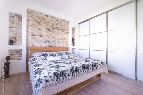 Loft style designed bedroom with double bed, build in wardrobe ...
