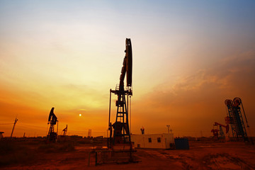 Sunset time of oil pump, oil industry equipment