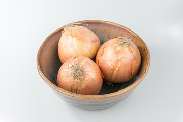 White Onions in a Clay Bowl