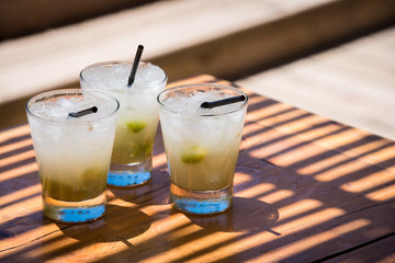 Three cold delicious caipirinhas ready to drink