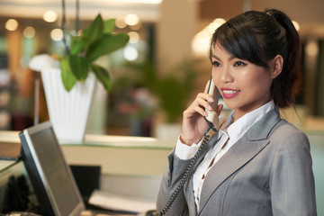 Receptionist having phone call