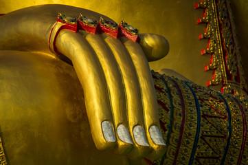 Golden image of buddha hand thai style
