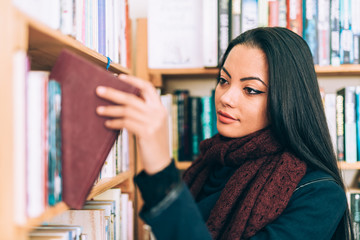 Beautiful mixed Asian woman in a library/book store.