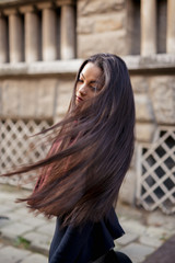 Beautiful Asian woman flipping her hair