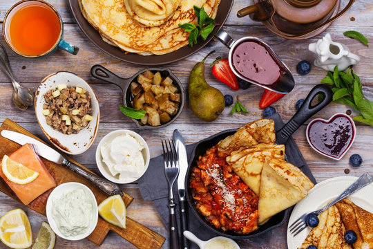 Colorful, tasty and savory breakfast with crepes and different fillings and sauces