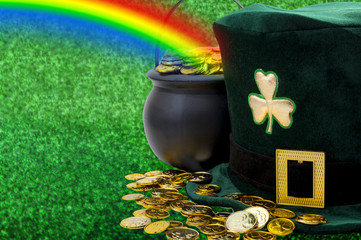March meme and Happy St patrick's day concept with green funny leprechaun hat with shamrock, pot of gold at the end of the rainbow and scattered golden coins with copy space across the banner
