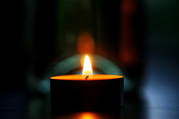 Candle in the dark room