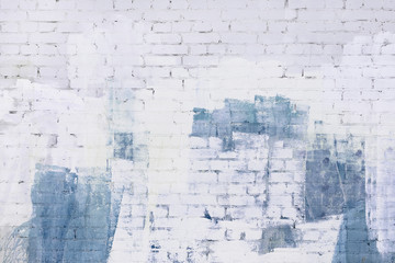 Brick wall painted abstractly with white and blue paint. Background, texture.