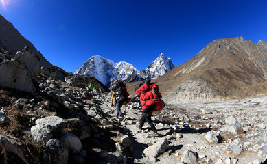 Nepalese carrying Luggage trekking on the way to everst base camp,nepal