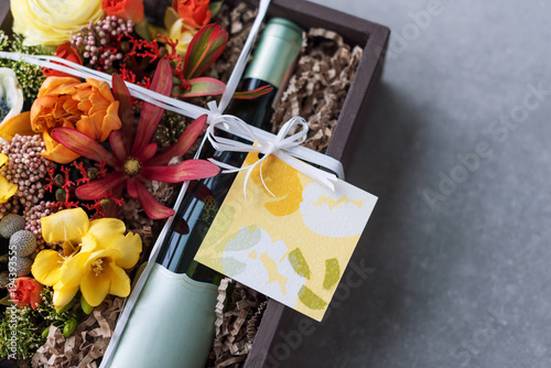 Bouquet of flowers with bottle of white wine in old wooden rustic bouquet of flowers with bottle of white wine in old wooden rustic box romantic present mightylinksfo