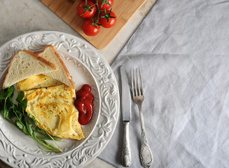 omelette on a plate, parsley, tomatoes, toast, ketchup