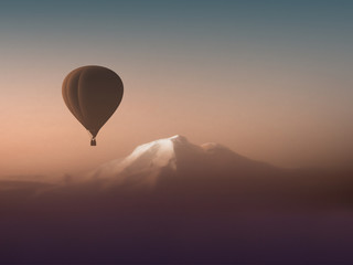 silhouette hot air balloon flying over the mountains. wonderful landscape mountain view copyspace. air sports travel aerostat