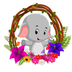 cute elephant in root of tree frame with flower
