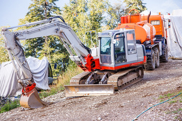 Picture of working excavator in summer day