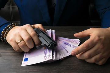 Money, weapons demonstrating the concept of a bandit. Terrorist activity.