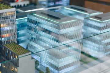 miniature model of modern city under glass