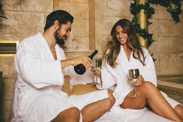 Beautiful young couple enjoying and relaxing in SPA center