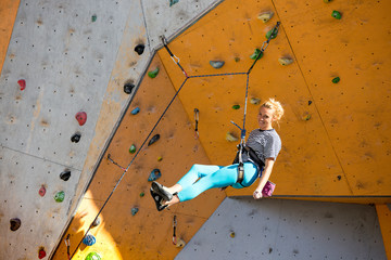 girl climbing up the wall