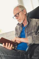 Portrait of mature man reading a book