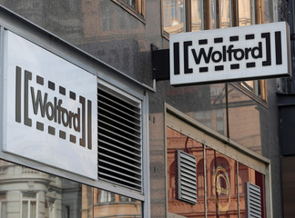 The logo of Austrian luxury textiles maker Wolford is seen outside a shop in the centre of Vienna
